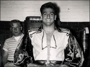 In this undated photo Dick Torio stands in his wrestling finery as he prepares to begin his match.