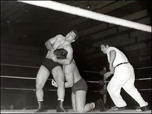 In this undated photo, Dick Torio has a headlock on his opponent. Torio, who attended the University of Toledo, wrestled in the AAU and compiled an impressive record.