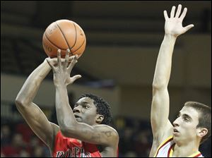 Rogers' Tony Kynard II (3) takes a shot against a trailing Brecksville-Broadville Heights' Paul Kathan (3).