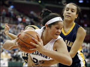 Notre Dame's Jayda Worthy (22) defends against  Kettering Fairmont's Makayla Waterman (24).