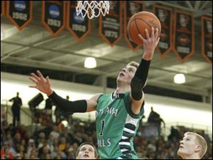 Ottawa Hills High School player Blake Pappas, 1, drives past Leipsic High School players Devin Mangas, 3, and Austin Barerra, 10, for a basket.