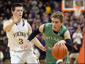 Ottawa Hills High School player Blake Pappas, 1, drives past Leipsic High School player Devin Mangas, 3.