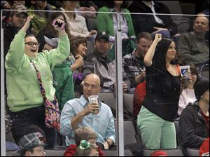 Fans danced decked out in green for St. Patrick's Day as the Toledo Walleye play the Wheeling Nailers.