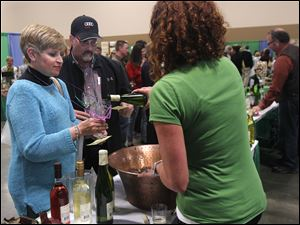 Michiganders Valarie Cerasuolo and Craig Baker sample Firelands Winery wine poured by Melissa Kadow.
