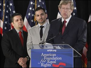 Ted Olson, right, lead Co-Counsel for the American Foundation for Equal Rights, seen with Proposition 8 paintiffs, Jeff Zarrillo, left, and Paul Katami, middle, comments on the announcement that California's same-sex marriage ban is unconstitutional during a American Foundation for Equal Rights conference in Los Angeles.