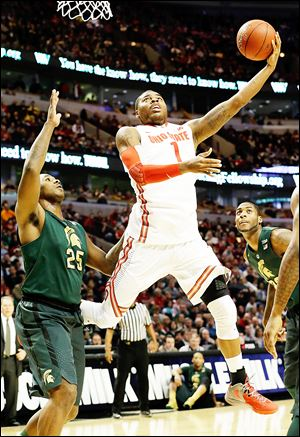 Ohio State's Deshaun Thomas shoots over Michigan State's Derrick Nix in a Big Ten semifinal. Thomas scored 16 points on 6-of-19 shooting in the Buckeyes' victory.