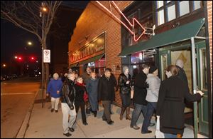 Ticket holders enter Ye Olde Cock N' Bull Tavern to sample its food during the Dishcrawl in downtown Toledo.