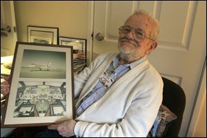 Ken Colthorpe, 91, with photos of the exterior and interior of a Champion company Gulfstream, circa 1980.