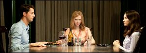 \Matthew Goode, left, Nicole Kidman and Mia Wasikowska, right, in a scene from