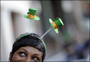 Krystal Thomas of Atlanta parties on River Street while wearing a shamrock head-band during the 189th St. Patrick's Day celebration in Savannah, Ga.