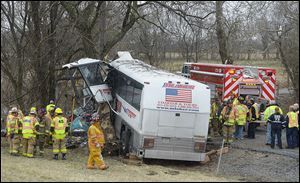 Emergency and rescue crews respond to the scene of a tour bus crash on the Pennsylvania Turnpike today near Carlisle, Pa.