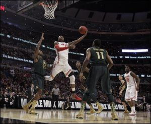 Ohio State's Deshaun Thomas goes up for a shot against Michigan State today at the United Center in Chicago.