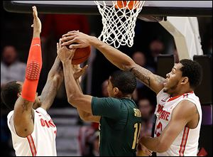 Amir Williams, right, and Deshaun Thomas, left, block a shot by MSU's Gary Harris in the Buckeyes' Big Ten semifinal win.