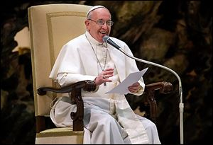 Pope Francis smiles during a meeting with the media at the Pope Paul VI Audience Hall in the Vatican on Saturday.
