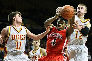 Keandre Gilmer of Rogers pulls in a rebound against Mark Chrzanowski of Brecksville-Broadview Heights.