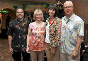 From left: Kesari and Cancy Sarikonda, and Lisa and Alan Sattler, president of the Flower Hospital, attend the ProMedical Flower Hospital Annual Medical staff dinner at Franciscan Center at Lourdes University in Sylvania, Ohio.