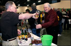 It's Your Winery's Dave Foltz pours Toledoan Bill McDaniel a sample during the Glass City Wine Festival at the SeaGate Convention Centre in Toledo. Festival attendees gave the event high marks.