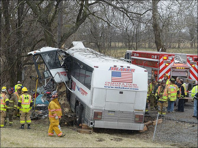 ADDITION Tour Bus Crash Pennsylvania Emergency and rescue crews respond to the scene of a tour bus crash on the Pennsylvania Turnpike today near Carlisle, Pa.