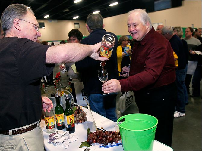 Wine fest Your Winery It's Your Winery's Dave Foltz pours Toledoan Bill McDaniel a sample during the Glass City Wine Festival at the SeaGate Convention Centre in Toledo. Festival attendees gave the event high marks.