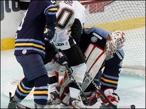 Walleye goalie Kent Simpson protects the goal against the Nailers' Tyler Pilmore.