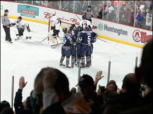 Fans and the team celebrate a goal made by Walleye's Kyle Rogers.