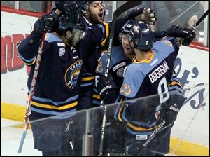 The Walleye celebrate Randy Rowe's goal.