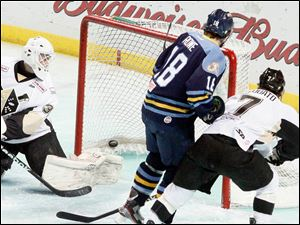 The Walleye's Randy Rowe scores a goal past the Nailers goalie Scott Darling.
