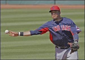 The Indians' Juan Diaz throws  out the Reds' Jason Donald from short in the third inning of Sunday's exhibition game. The two teams ended the game tied at 7 after nine innings.