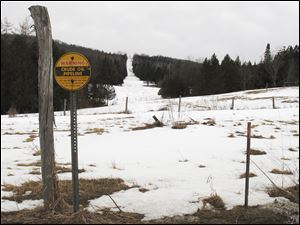 A sign indicates a section of a buried crude oil pipeline in Burke, Vt. Canadian energy officials insist they have no plans to reverse the flow of the pipeline that now carries crude oil from Maine to Montreal, but that has done little to reassure New England towns that are against the idea and the 18 members of Congress asking for a full environmental review.