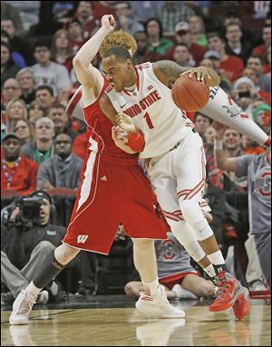 Deshaun Thomas, who paced Ohio State with 17 points, drives against Wisconsin's Mike Bruesewitz.