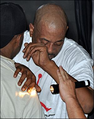 Rapper Tone Loc is assisted during a previous collapse on stage during a May, 2009 performance at Capt'n Fun Beach Club on Pensacola Beach, Fla. Tone Loc didn't want to be hospitalized after collapsing on stage during a recent weekend performance in Iowa.
