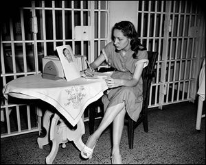"Ruth Steinhagen, 19, held in the shooting of Philadelphia Phillies first baseman Eddie Waitkus at a Chicago hotel on June 14, 1949, writes notes for her life history in Cook County Jail in Chicago. Steinhagen died of natural causes at 83 in late December, 2012. She was the inspiration for Bernard Malamud's novel ""'The Natural'"" and the 1984 movie starring Robert Redford."