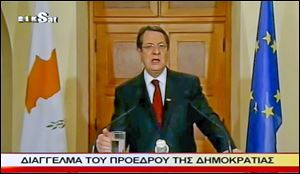 In an image made from video, Cyprus' President Nicos Anastasiades addresses the nation in a broadcast on Sunday about trying to amend a bailout plan.