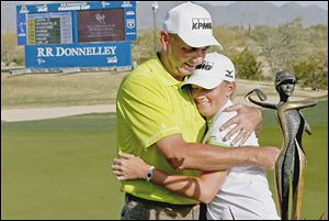 Stacy Lewis, a Toledo native, gets a hug from her father, Dale Lewis, after winning the LPGA Founders Cup. Dale is a Whitmer graduate.