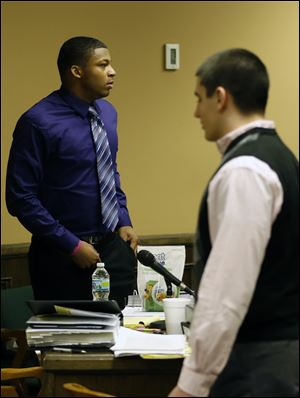 Ma'lik Richmond, 16, left, and co-defendant Trent Mays, 17,  right, walks around in the court room during a break Saturday in Steubenville.