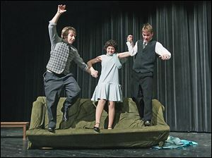 Brent Schermbeck, 15, left, Tori Treadaway, 16, center, and Shawn Giffin, 18, right, pereform 'Good Morning' during a run-through of Bowsher High School's production of 'Singin' in the Rain.'