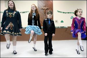 Luke Morelock, 8, center right, watches fellow members of the Ardan Academy of Irish Dance, from left, Reagan McLaughlin, Camille Morelock, and Adelie Semproch. The children performed Sunday at the annual festival sponsored by the Hibernians at the Knights of Columbus hall in West Toledo.