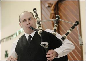 Robert Hosey plays the bagpipes at the Irish festival. The family friendly event offered contemporary and traditional music, as well as dancing and Irish food.