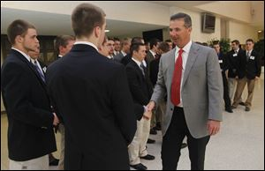 Ohio State coach Urban Meyer shakes hands with high school football players honored at the National Football Foundation banquet at the Stranahan Theater.