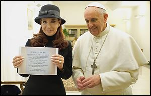 Pope Francis poses Monday at the Vatican with Argentine President Cristina Fernandez, who holds a photo of a plaque marking a treaty between Argentina and Chile. The Pontiff had denounced Ms. Fernandez's policies on contraception and gay marriage.