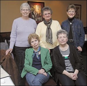 Connie Brack and Jan Peacock, seated from left,  and Gladys Pierson, Barbara Szyperski, and Mona Rathke, standing from left, meet at Eddie Lee's this month. Gladys Pierson says the reason for their bond is simple:  '... we just have a really good time together.'