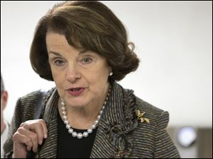 FILE - In this Feb. 25, 2013 file photo, Sen. Dianne Feinstein, D-Calif. speaks with reporters on Capitol Hill in Washington. Feinstein, the sponsor of a proposed assault weapons ban says Senate Majority Leader Harry Reid has told her that the ban will not be part of the initial gun control measure the Senate will debate next month. (AP Photo/J. Scott Applewhite, File)