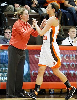 BGSU coach Jennifer Roos, left, and Chrissy Steffen will host SMU on Thursday night. The Falcons committed 34 turnovers in their last game, an 81-48 loss to Central Michigan in the third round of the Mid-American Conference tournament.