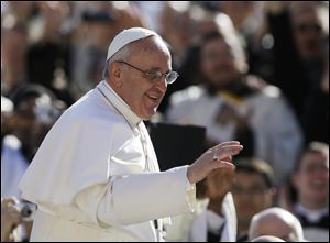 Pope Francis waves to crowds as he arrives at his inauguration Mass in St. Peter's Square at the Vatican.