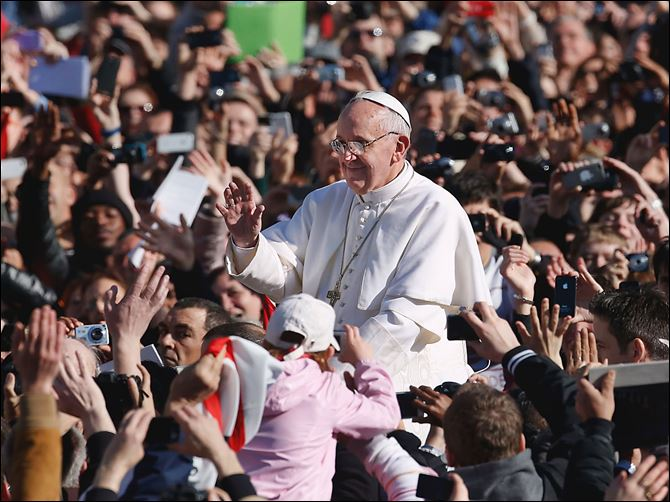 Francis among the masses Pope Francis is greeted by a crowd of 200,000  as he arrives in St. Peter's Square for his Inaugural Mass at the Vatican.  The crowd Tuesday ranged from kings to beggars, including dignitaries from more than 130 nations.