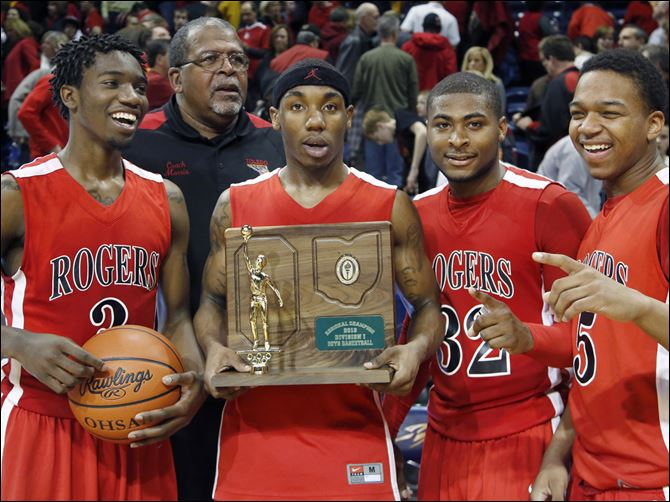 Rogers state semis From left, Tony Kynard, coach Earl Morris, Clemmye Owens, DeVonte Pratt, and Chris Austin accept the Division I regional championship trophy after beating Brecksville-Broadview Heights 63-61 in overtime. The Rams (20-7) play third-ranked Cincinnati Walnut Hills (27-1) in the state semifinals.