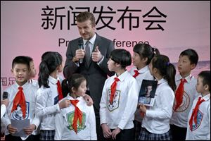 David Beckham speaks during a promotional event at Shijia Primary School in Beijing.