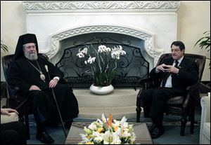 Following the talks with President Anastasiades, right, the head of Cyprus' influential Orthodox church Archbishop Chrysostomos II, left, said on today that he will p