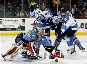 Walleye goalie Kent Simpson blocks a shot by Evansville's Adam Pleskach during the second period on Wednesday. Simpson made 26 saves and recorded his second straight shutout, helping the Walleye earn two critical points with five regular season games remaining before the playoffs begin.