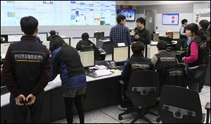 Employees of Korea Internet Security Center work after computer networks at two major South Korean banks and three top TV broadcasters went into shutdown mode en masse, at a monitoring room in Seoul, South Korea.